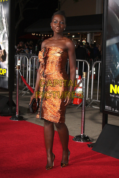 LOS ANGELES, CA - FEBRUARY 24: Lupita Nyong'o at the &quot;Non-Stop&quot; Premiere, Village Theater, Westwood,  February 24, 2014. <br /> CAP/MPI/JO<br /> &copy;JO/MPI/Capital Pictures
