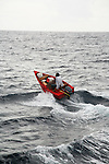 Scenes from whale watching trip, including local fisherman in very small boat