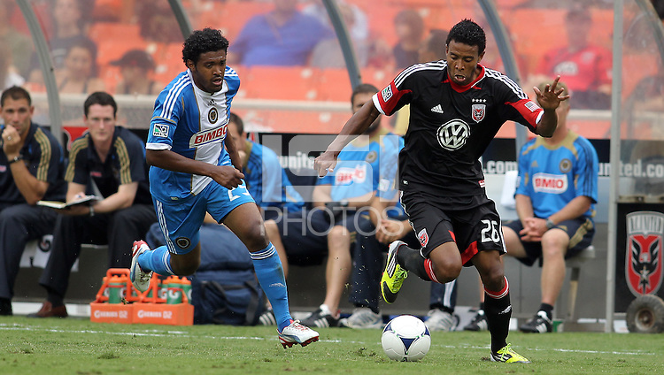 WASHINGTON, D.C. - AUGUST 19, 2012:  Lionard Pajoy (26) of DC United pulls away from Sheanon Williams (25) of the Philadelphia Union during an MLS match at RFK Stadium, in Washington DC, on August 19. The game ended in a 1-1 tie.
