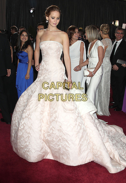 Jennifer Lawrence (wearing Dior Haute Couture).85th Annual Academy Awards held at the Dolby Theatre at Hollywood & Highland Center, Hollywood, California, USA..February 24th, 2013.oscars full length white pale pink strapless dress gown voluminous clutch bag full-tiered skirt  .CAP/ADM/RE.©Russ Elliot/AdMedia/Capital Pictures.
