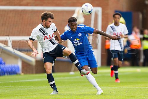 18.07.2015.  Peterborough, Engand. Pre Season Friendly Peterborough United versus Tottenham Hotspur. Kenny McAvoy (Tottenham Hotspur) holds off Kgosi Ntihe (Peterborough United).