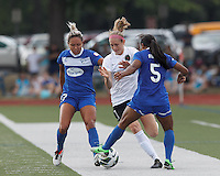 Portland Thorns FC defender Nikki Marshall (7) works against two defenders: Boston Breakers forward Kyah Simon (17) and Boston Breakers midfielder Jazmyne Avant (5). In a National Women's Soccer League (NWSL) match, Portland Thorns FC (white/black) defeated Boston Breakers (blue), 2-1, at Dilboy Stadium on July 21, 2013.