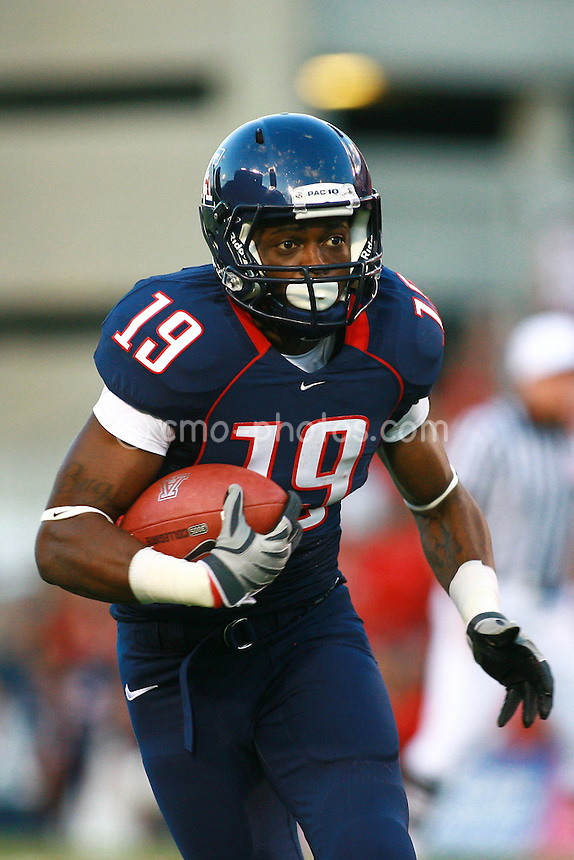 "Oct 17, 2009; Tucson, AZ, USA; Arizona wide receiver William ""Bug"" Wright (19) runs after a reception during the 2nd quarter of a game against the Stanford Cardinal at Arizona Stadium."