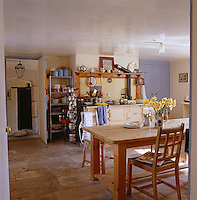 An Aga dating from the 1940's dominates the stone-flagged kitchen which is furnished with a pine table and chairs