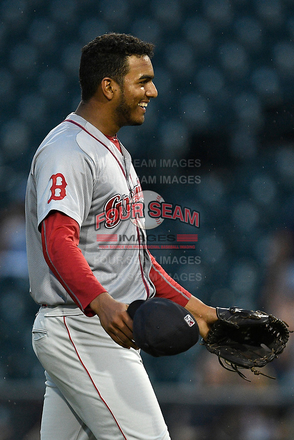 Pitcher Denyi Reyes (41) of the Greenville Drive breaks into a grin after posting the final out in a nine-inning complete-game shutout against the Columbia Fireflies on Sunday, May 27, 2018, at Spirit Communications Park in Columbia, South Carolina. Greenville won, 3-0. It was the first complete-game shutout in the South Atlantic League this season.(Tom Priddy/Four Seam Images)