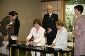 First lady Laura Bush, joined by her mother, Mrs. Jenna Welch, right, is given whisking instructions by Ms. Sakiko Akiyama, executive assistant to Grand Master Sen Genshitsu, left, while participating in a Japanese Tea Ceremony, Monday, April 17, 2006, in Washington, DC, with H.E. Ryozo Kato, Ambassador of Japan to the US, and his wife, Mrs. Hanayo Kato. <br /> Mandatory Credit: Shealah Craighead / White House via CNP