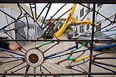 Bicycle part gate at LA Eco-Village. Started in 1993, LA Eco-Village demonstrates the processes for creating a healthy neighborhood ecologically, socially and economically and to reduce environmental impacts while raising the quality of neighborhood life.