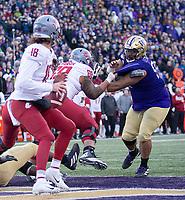 Tuli Letuligasenoa tries to get to Cougar quarterback Anthony Gordon.