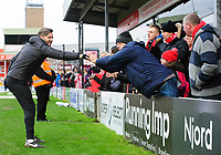 Lincoln City's assistant manager Nicky Cowley shakes hands with fans at the end of the game<br /> <br /> Photographer Chris Vaughan/CameraSport<br /> <br /> The EFL Sky Bet League Two - Lincoln City v Grimsby Town - Saturday 19 January 2019 - Sincil Bank - Lincoln<br /> <br /> World Copyright © 2019 CameraSport. All rights reserved. 43 Linden Ave. Countesthorpe. Leicester. England. LE8 5PG - Tel: +44 (0) 116 277 4147 - admin@camerasport.com - www.camerasport.com