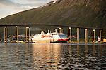 Hurtigruten ferry ship Nordlys approaching Tromso passing under cantilever bridge, Norway