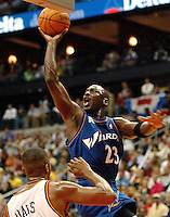 NBA legend Michael Jordan shoots a one-handed jumper during his stint with the Washington Wizards.