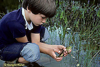 FA27-089z  Boy holding frog at pond