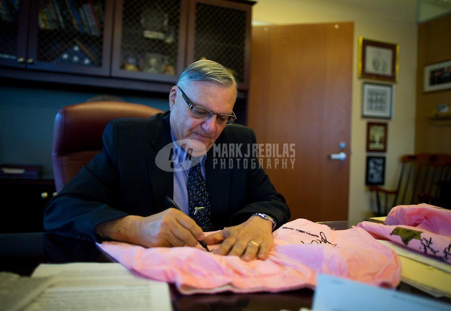 Jan 21, 2015; Phoenix, AZ, USA; Maricopa County sheriff Joe Arpaio autographs pairs of pink boxer underwear in his office in downtown Phoenix. Mandatory Credit: Mark J. Rebilas-
