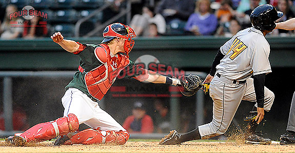 Catcher Jordan Weems (18) of the Greenville Drive gets the throw too late to make the tag on Francisco Diaz (44) in a game against the West Virginia Power on Monday, April 15, 2013, at Fluor Field at the West End in Greenville, South Carolina. West Virginia won, 6-0. (Tom Priddy/Four Seam Images)