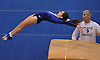 Allison Cohen of Long Beach soars through the air on the vault as coach Billy Muirhead watches her during a varsity gymnastics meet against Bethpage at Long Beach High School on Monday, Jan. 4, 2016. Long Beach won the meet by a score of 151.55-147.60.