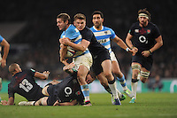 Owen Farrell of England wraps up Santiago Cordero of Argentina during the Old Mutual Wealth Series match between England and Argentina at Twickenham Stadium on Saturday 26th November 2016 (Photo by Rob Munro)
