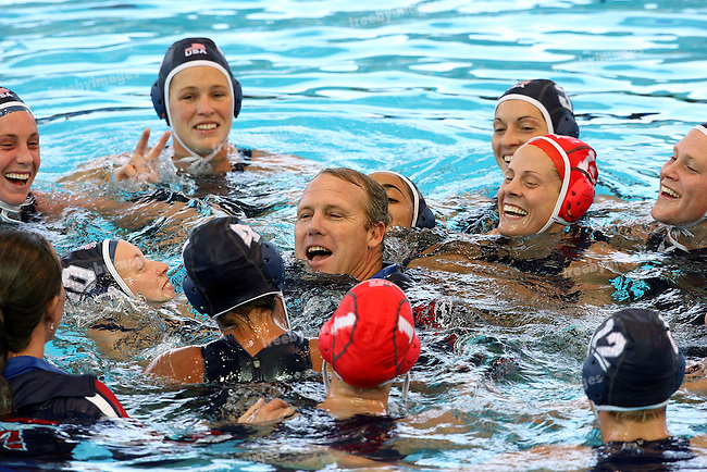 12th Fina World Swimming Championships Melbourne, 2007, USA Team celebrate winning the gold medalwith a quick swim for the coach. Waterpolo gold Medal game between Australia and USA 31st March  USA won the gold