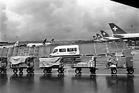 Switzerland. Zürich Airport. Planes at gates. Swissair flights on the tarmac. Swissair van. Rainy day. Swissair was the former national airline of Switzerland. For most of its 71 years, Swissair was one of the major international airlines and was regarded as a Swiss national symbol and icon. The airline was declared bankrupt on March 31 2002. © 1995 Didier Ruef