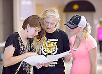 NWA Democrat-Gazette/BEN GOFF &bull; @NWABENGOFF<br /> Mikayla Shefchik (from left) and fellow freshman Katlynn (CQ) Matthews, both 14, look over their schedules with Matthews' mother Katerina Matthews on Thursday Aug. 6, 2015 during student schedule pickup at Bentonville High School. Bentonville High and other traditional-schedule schools in the district resume classes on Tuesday, Aug. 18.