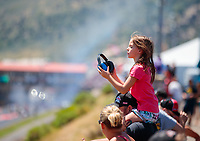 Jul 21, 2019; Morrison, CO, USA; A young female NHRA fan in the crowd during the Mile High Nationals at Bandimere Speedway. Mandatory Credit: Mark J. Rebilas-USA TODAY Sports