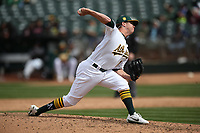 OAKLAND, CA - APRIL 18:  Emilio Pagan #15 of the Oakland Athletics pitches against the Chicago White Sox during the game at the Oakland Coliseum on Wednesday, April 18, 2018 in Oakland, California. (Photo by Brad Mangin)