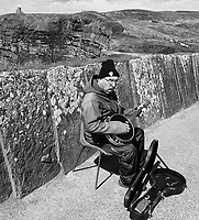 A busquer plays for tourists at the Cliffs of Moher.