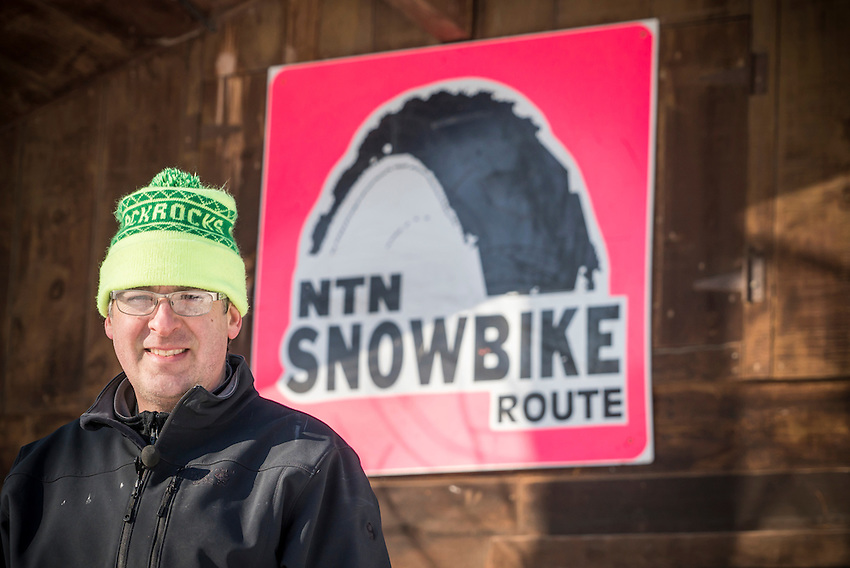 Noquemanon Trails Network board member Mike Brunet with some of the equipment developed for the Snow Bike Route of winter singletrack in Marquette, Michigan.