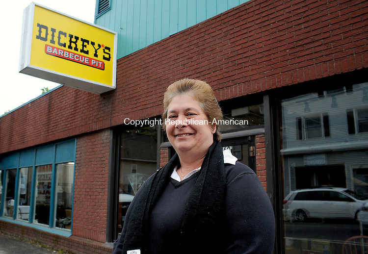 NAUGAUCK,  CT, 03 MAY  2012-050312JS01--Donna Ferrari, co-owner of Dickey's Barbecue Pit with her husband Mark, outside their location at 160 Rubber Avenue in Naugatuck. Ferrari is hoping to open near the end of the month. .Jim Shannon Republican-American