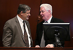 Nevada Assemblyman James Oscarson, R-Pahrump, left, and Speaker John Hambrick talk on the Assembly floor at the Legislative Building in Carson City, Nev., on Monday, Feb. 9, 2015. <br /> Photo by Cathleen Allison