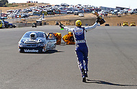 Jul. 28, 2013; Sonoma, CA, USA: NHRA pro stock motorcycle winner Hector Arana Jr runs to celebrate with friend, pro stock winner Vincent Nobile during the Sonoma Nationals at Sonoma Raceway. Mandatory Credit: Mark J. Rebilas-