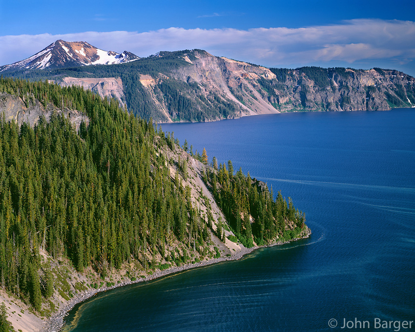 ORCL_060 - USA, Oregon, Crater Lake National Park, Conifer pollen sccumulates on surface of Crater Lake at Cleetwood Cove while Mount Scott rises in the distance.