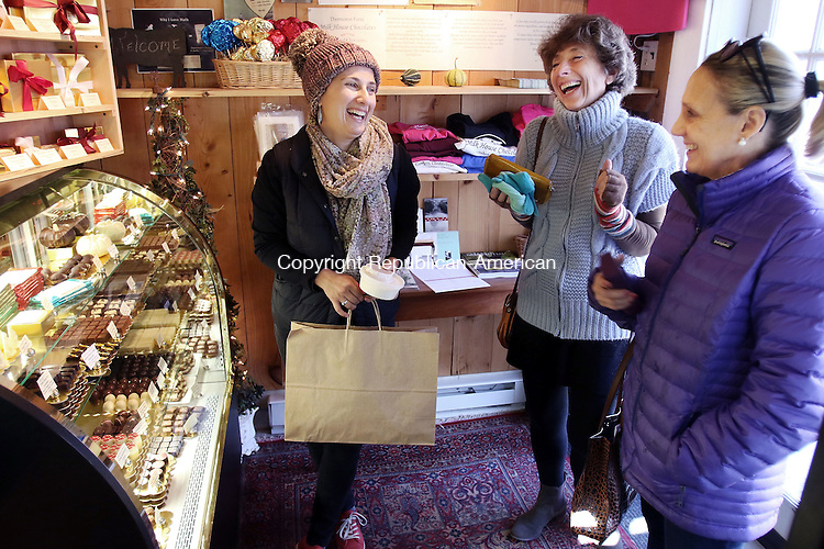 GOSHEN CT. 24 November 2015-112415SV12-From left, Val Khislavsky of Canton, Alla Yanovsky Tilton of Canton, and Pamula McCann of Litchfield shop for holiday chocolate at Thorncrest Farm in Goshen Tuesday. <br /> Steven Valenti Republican-American