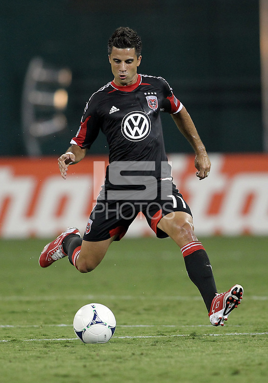 WASHINGTON, DC. - AUGUST 22, 2012:  Marcelo Saragosa (11) of DC United makes a pass against the Chicago Fire during an MLS match at RFK Stadium, in Washington DC,  on August 22. United won 4-2.