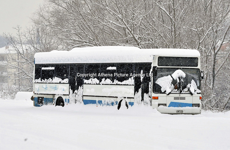 Pictured: A city bus covered in snow in Ioannina, Greece. Wednesday 11 January 2017<br /> Re: Heavy snow has affected the town of Ioannina, northern Greece