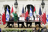 """From left to right: Dr. Abdullatif bin Rashid Alzayani, Minister of Foreign Affairs, Kingdom of Bahrain; Prime Minister Benjamin Netanyhu of Israel; United States President Donald J. Trump and Sheikh Abdullah bin Zayed bin Sultan Al Nahyan, Minister of Foreign Affairs and International Cooperation of the United Arab Emirates sign the """"Abraham Accords"""" on the South Lawn of the White House in Washington, DC on Tuesday, September 15, 2020. <br /> Credit: Chris Kleponis / Pool via CNP"""