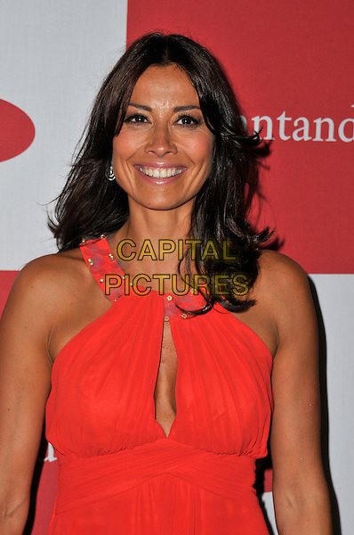 Melanie Sykes.The launch of the London Grand Prix by Santander at the Royal Automobile Club, London, England..June 28th, 2012.half length red sleeveless cleavage .CAP/WIZ.© Wizard/Capital Pictures.