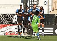 (left to right) Earthquakes' Brandon McDonald, Ike Opara, Bobby Burling and Ramiro Corrales try to block Sounders' Fredy Montero's kick during the game at Buck Shaw Stadium in Santa Clara, California on July 31st, 2010.   Seattle Sounders defeated San Jose Earthquakes, 1-0.