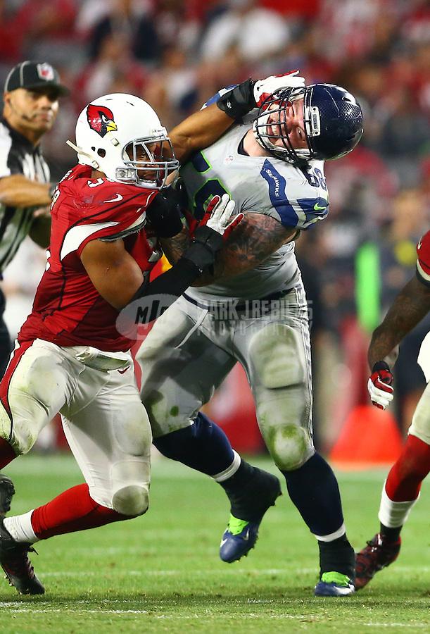 Jan 3, 2016; Glendale, AZ, USA; Arizona Cardinals linebacker Kevin Minter (left) battles Seattle Seahawks guard Justin Britt at University of Phoenix Stadium. Mandatory Credit: Mark J. Rebilas-USA TODAY Sports