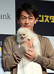 "September 8, 2016, Tokyo, Japan - Japanese actor Takeru Sato, holds a pomeranian dog Giga-chan in his arms as he announces Softbank's new rate plan ""Giga monster"", 20GB for 6,000 yen per month in Tokyo on Thursday, September 8, 2016. Softbank also annouced they will start the fifth generation (5G) mobile communication service Massive MIMO in this month    (Photo by Yoshio Tsunoda/AFLO) LWX -ytd-"