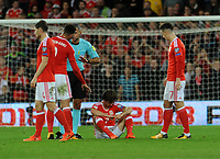 Wales Joe Allen sits down injured and is taken off shortly after <br /> <br /> Photographer Ian Cook/CameraSport<br /> <br /> FIFA World Cup Qualifying - European Region - Group D - Wales v Republic of Ireland - Monday 9th October 2017 - Cardiff City Stadium - Cardiff<br /> <br /> World Copyright &copy; 2017 CameraSport. All rights reserved. 43 Linden Ave. Countesthorpe. Leicester. England. LE8 5PG - Tel: +44 (0) 116 277 4147 - admin@camerasport.com - www.camerasport.com