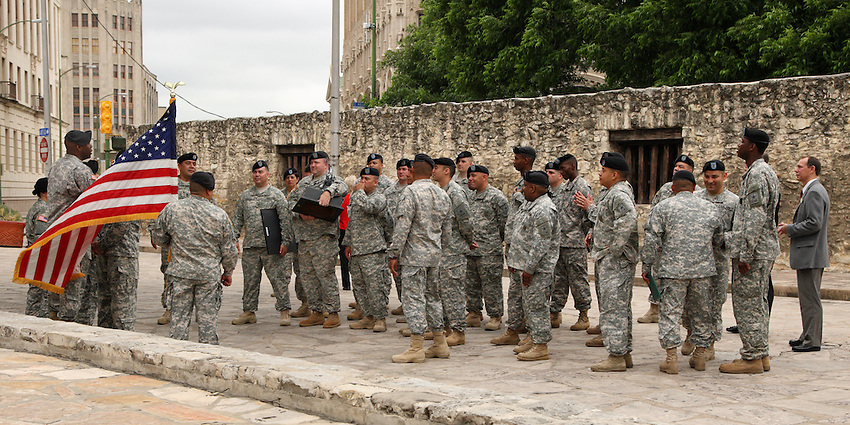 Military graduation ceremony along the wall surrounding the old Texas Alamo.