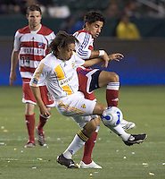 LA Galaxy MID Cobi Jones battles FC Dallas Marcelo Saragosa for a ball during a MLS match. FC Dallas beat LA Galaxy 2-1 at the Home Depot Center in Carson, California, Thursday April 12, 2007.
