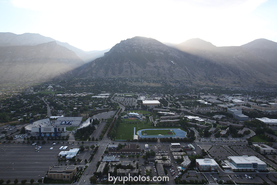 1309-22 0565<br /> <br /> 1309-22 BYU Campus Aerials<br /> <br /> Brigham Young University Campus West looking East, Provo, Sunrise, Y Mountain, Lavell Edwards Stadium LES, Outdoor Track  and Field Complex TRAK <br /> <br /> September 7, 2013<br /> <br /> Photo by Jaren Wilkey/BYU<br /> <br /> &copy; BYU PHOTO 2013<br /> All Rights Reserved<br /> photo@byu.edu  (801)422-7322