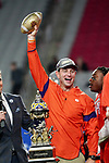 Clemson Tigers head coach Dabo Swinney holds the trophy after the Fiesta Bowl game against the Ohio State Buckeyes on Saturday, Dec 28, 2019 in Glendale, Ariz.  (Gene Lower via AP)