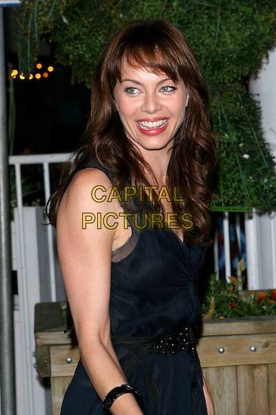 MELINDA CLARKE.Fox TCA Party, .Santa Monica, 29th July 2005.half length black v-neck dress bracelet bangle mouth teeth.www.capitalpictures.com.sales@capitalpictures.com.© Capital Pictures.