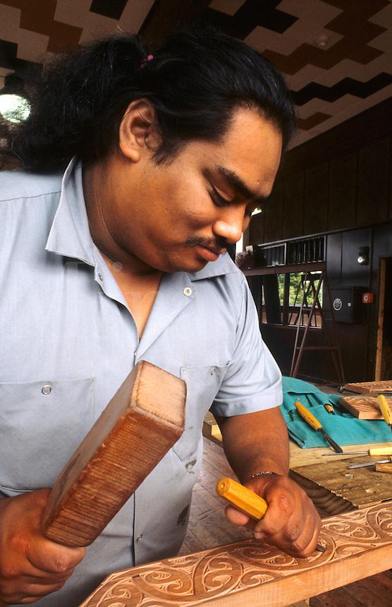 Maori Artist doing artwork carvings in his studio at Rotorua, New Zealand