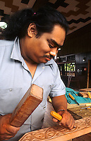 Maori Artist doing artwork carvings in his studio at Rotorua, New Zealand
