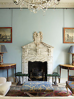 A George I marble chimneypiece in the sitting room is the impressive focal point of the room.