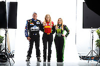 Feb 8, 2017; Pomona, CA, USA; NHRA funny car driver John Force (left) with daughter Courtney Force (center) and top fuel driver Brittany Force pose for a portrait during media day at Auto Club Raceway at Pomona. Mandatory Credit: Mark J. Rebilas-USA TODAY Sports
