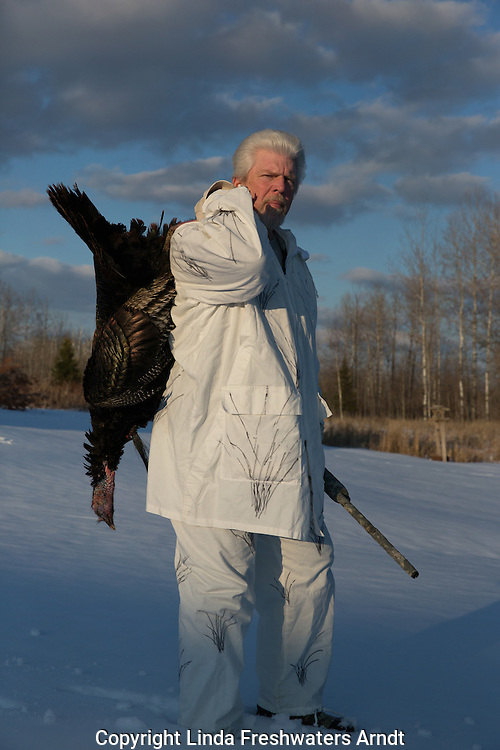 Hunter holding harvested eastern wild Turkey